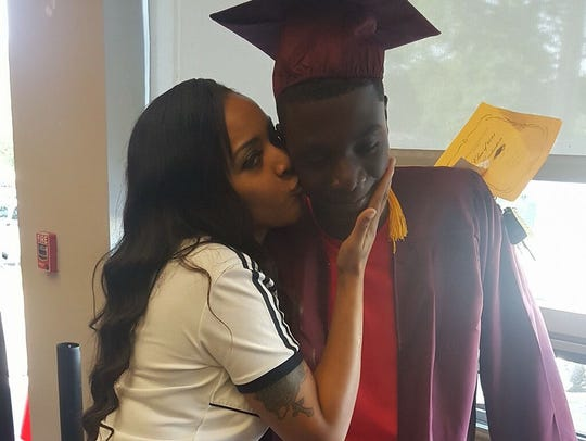 Dennis King is seen with his mom, Dombanee Lincoln,