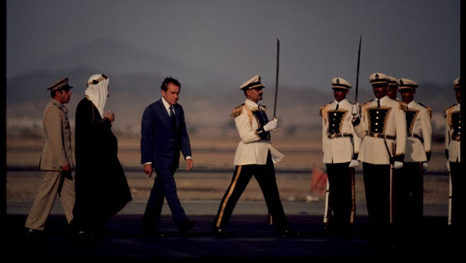President Nixon walks with Saudi King Faisal in in Saudi Arabia in June, 1974. Nixon traveled to the Middle East on a goodwill trip intended to continue mediation that helped to end the recent attack by Egypt and Syria on Israel.