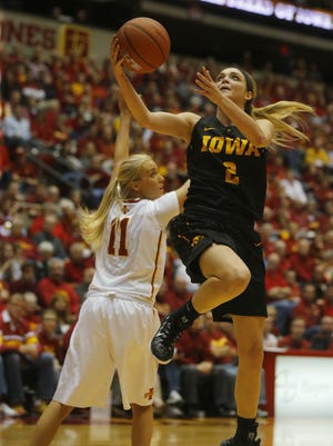 Iowa's Ally Disterhoft goes up for a shot while being guarded by Iowa State's Jadda Buckley during the CyHawk women's basketball game at Hilton Coliseum in Ames, Friday, Dec. 11, 2015.