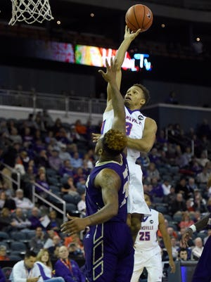 Jaylon Brown of University of Evansville releases a shot over  Reginal Johnson of Alcorn State during the first half of the game at the Ford Center in Evansville Monday.