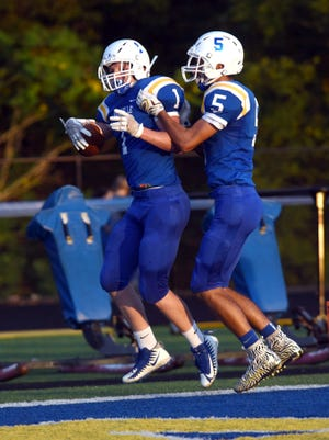 Maysville's Carson Jarrett celebrates with Ethan Evancho after catching a 17-yard touchdown in the first quarter of the Panthers' 33-14 win against New Lexington on Friday night.