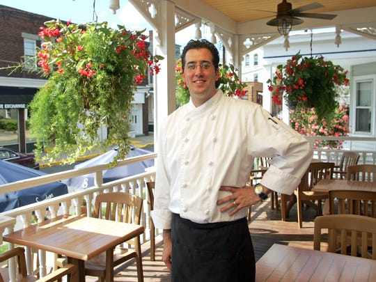 Matt McPherson, the Chef/Proprietor of Matt's Red Rooster Grill in Flemington, stands in the porch dining area.