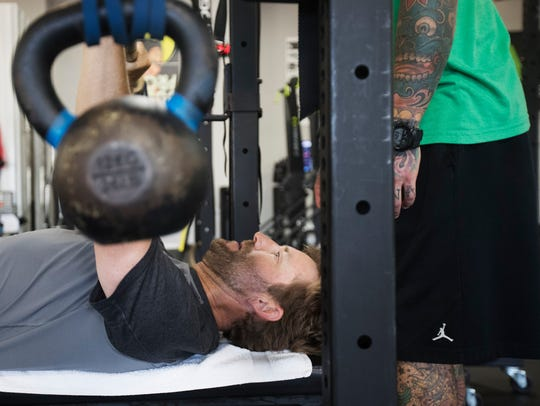 Professional golfer, George McNeill works out at Iron