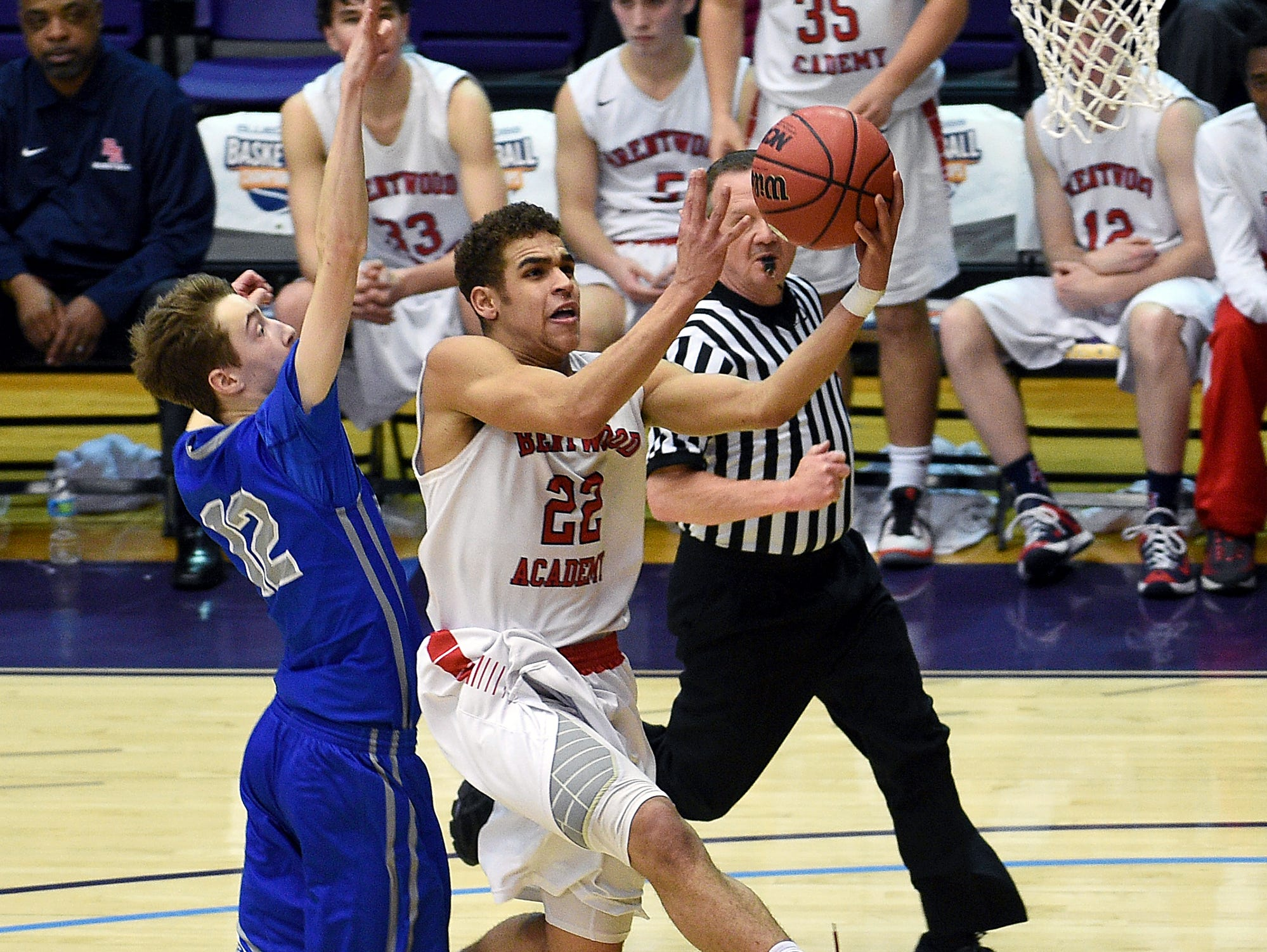 Brentwood Academy's Cam Johnson (22) shoots a layup against McCallie's Henley Edge (12) during the TSSAA Boys DII-AA semifinal at Lipscomb University on March 4, 2016.