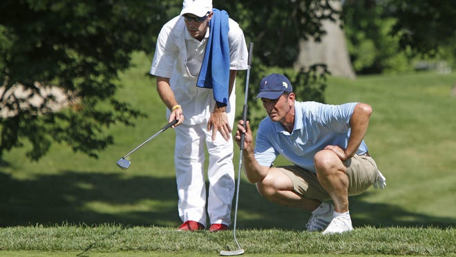 Ken Bakst of Friar's Head lines his putt on the 9th green in the William Rice Hochster Memorial Tournament at Quaker Ridge Golf Club June 22, 2015 in Scarsdale.