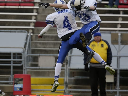 St. Mary's Springs' Blake Bauer (No. 4) and Fintan