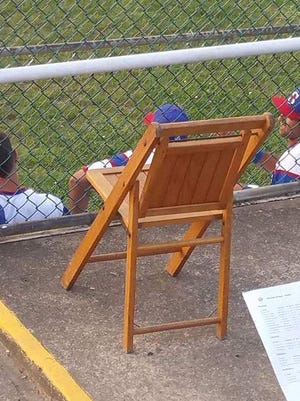 A chair is reserved for Kenny Grant, one of the Braves biggest fans, at John Moxie Stadium.