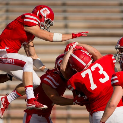 Cornell players pile onto Ben Rogers after he made