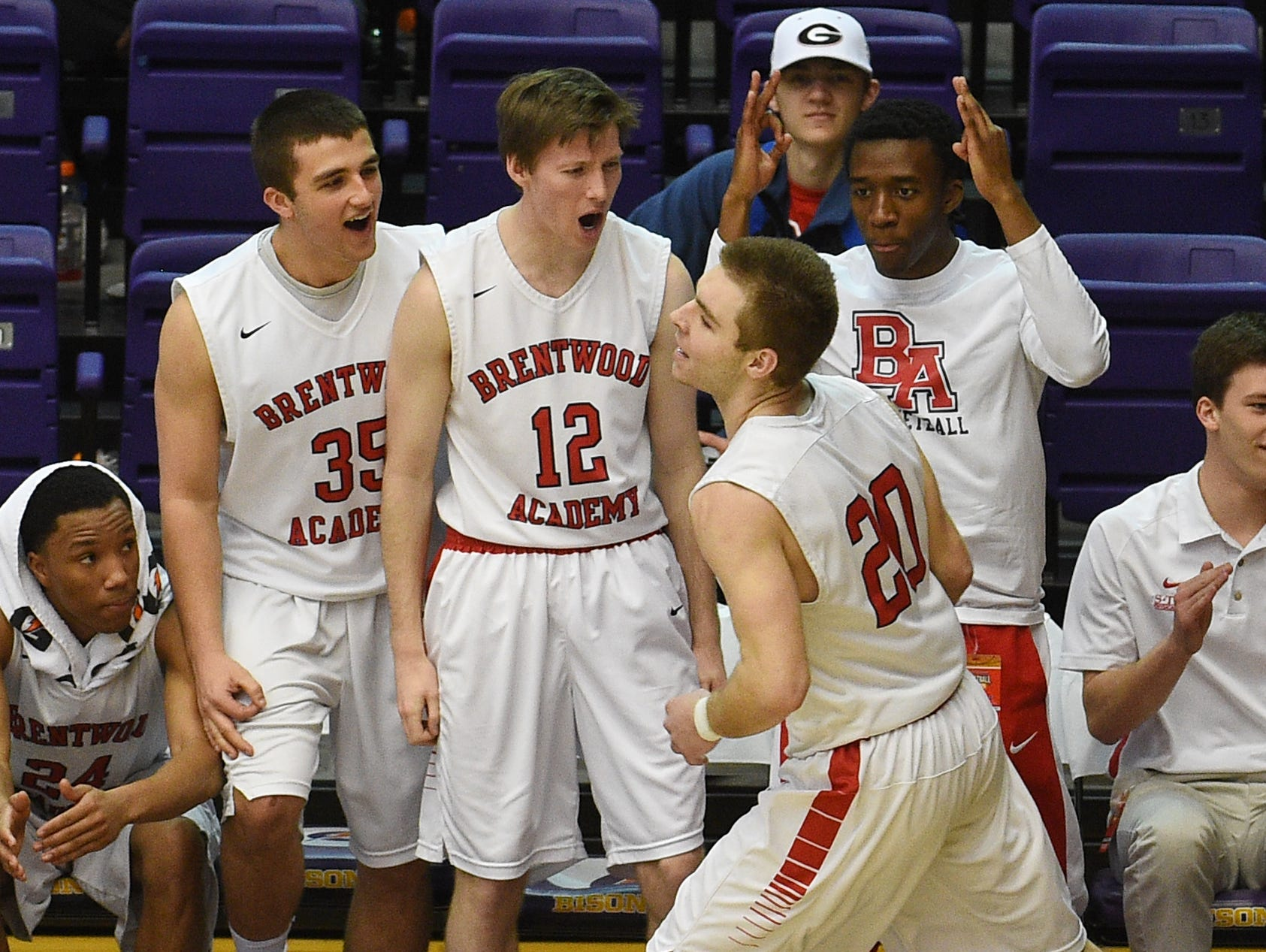 Brentwood Academy celebrates after Jeremiah Oatawall (20) scores during the TSSAA DII-AA semifinals at Lipscomb University on March 4, 2016.