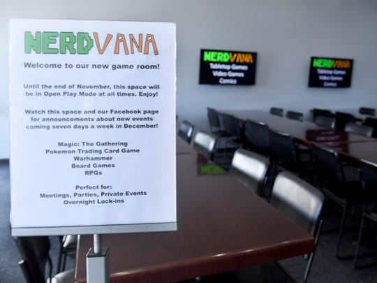 A sign welcomes customers to the new NerdVana game