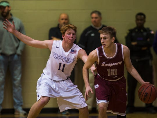 Christian Brothers High School player Cooper Cash (11) defends Montgomery Bell Academy's Drew Weikert (10) during the second half of the state quarterfinals TSSAA Division 2 Class 2AA game at CBHS on Saturday.