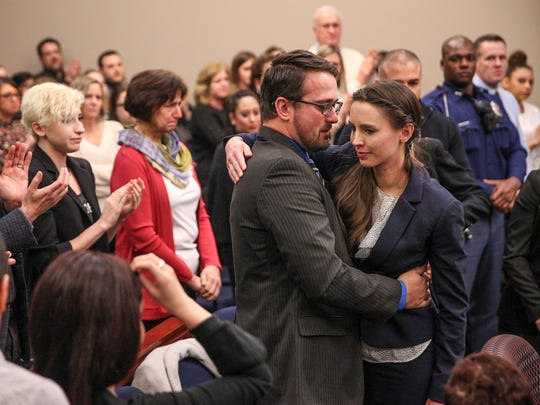 After delivering her impact statement in front of former USA Gymnastics doctor Larry Nassar, Rachael Denhollander is hugged by her husband, Jacob, inside Ingham County Circuit Court in Lansing, Mich., Wednesday, Jan. 24, 2018.