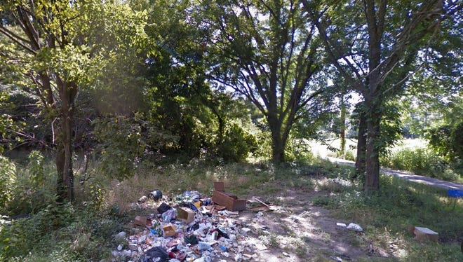 A pile of trash is captured in this Google photo taken in July 2014 in the 1600 block of Grimes Street. This is in the same area where a woman recently was charged with aggravated criminal littering, felony vandalism between $2,500 and $10,000, and two counts of misdemeanor violation of the Solid Waste Disposal Act.