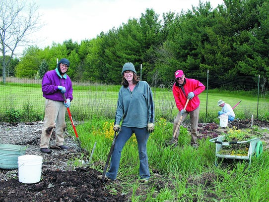 Preparing the UCC Community Garden for planting are