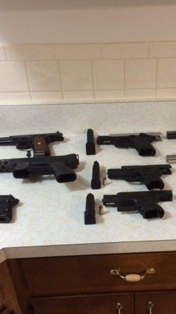 Guns seized in a 2014 police raid in Port Chester.
