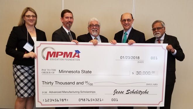 Minnesota Precision Manufacturing Association, from left, Executive Director Amy Walstien, Treasurer John Madsen, and President Tom Chacon.  Minnesota State Colleges and Universities Board of Trustees Chair Michael Vekich, Interim Chancellor Devinder Malhotra.