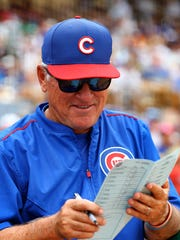Chicago Cubs manager Joe Maddon chuckles during a game