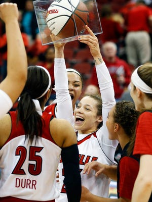 Louisville's Briahanna Jackson celebrates with the rest of the Cards after reaching her 1000th career point. Jan. 7, 2015