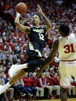 Purdue Boilermakers forward Vince Edwards (12) is fouled by Indiana Hoosiers center Thomas Bryant (31) in the first half of their game Thursday, February 9, 2017, evening at Assembly Hall in Bloomington IN.