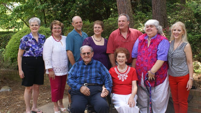 Joseph and Madeline Moyer, front, with their seven children: (back, left to right) Kathleen, Jeanne, Tom, Carole, Robert, JoAnne and Catherine at Mr. Moyer's 90th birthday party last year.
