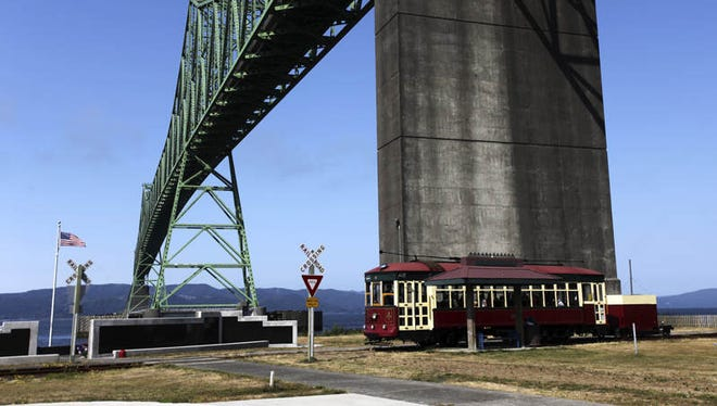 The trolley under the Astoria-Megler Bridge, along the Riverwalk. As Astoria celebrates its 200th birthday this year, the city has shed much of its hardscrabble past and looks forward to a newly tourist-driven future.