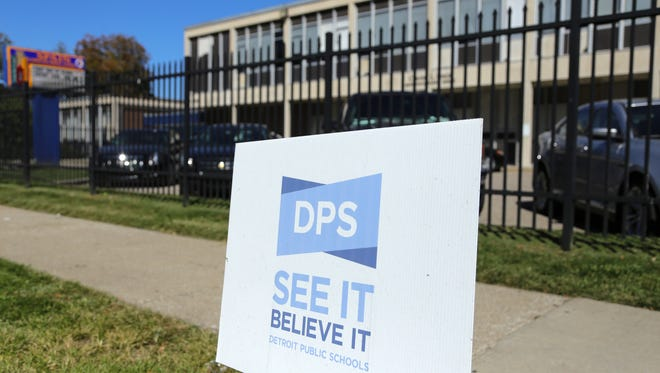 A sign for Detroit Public Schools is posted outside of Spain Elementary School in Detroit in September 2014.