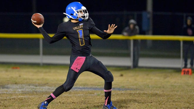 Valley quarterback Brayden Campos throws the ball during the game against Waggener at Valley High School.