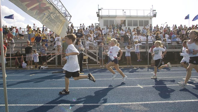 Parents watch near the finish line on the track at Middletown South High School during the 2007 Great Race.