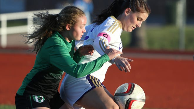 Fossil Ridge's Remi Clarke, right, was named to CHSAA's Class 5A All-State team Wednesday.