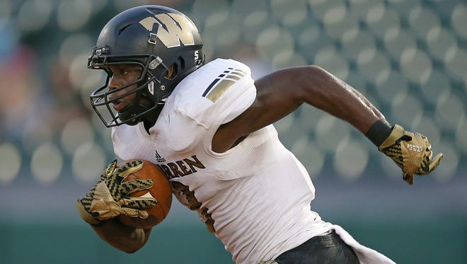 Warren Central Warriors Dijon Anderson (3) makes a long run down the field leading the Warriors to a touchdown on the next play, during first half action of the Gridiron Classic at Victory Field, Indianapolis, Friday, September 23, 2016.