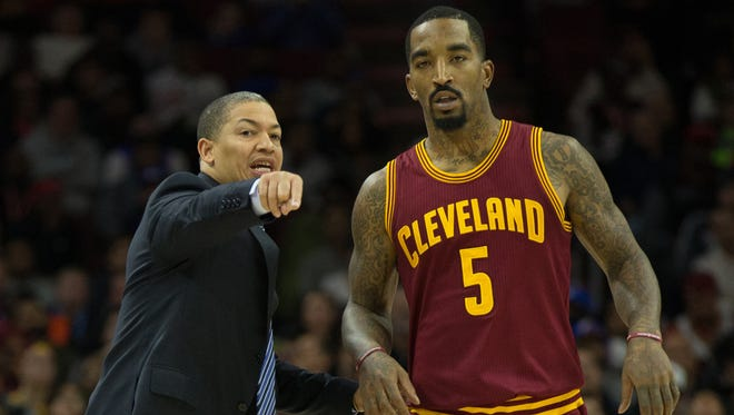 Cleveland Cavaliers head coach Tyronn Lue talks with guard J.R. Smith (5) during the fourth quarter against the Philadelphia 76ers at Wells Fargo Center.