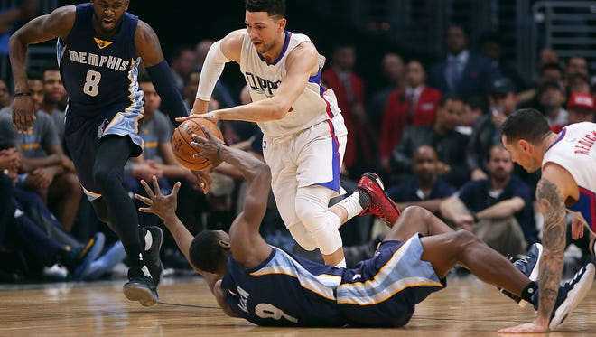 The Los Angeles Clippers' Austin Rivers steals the ball from the Mempis Grizzlies' Tony Allen in the first half at Staples Center in Los Angeles on Wednesday, Jan. 4, 2017.  (Robert Gauthier/Los Angeles Times/TNS)