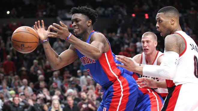 Detroit Pistons forward Stanley Johnson, left, loses a ball out of bounds against the Portland Trail Blazers on Jan. 8, 2017.