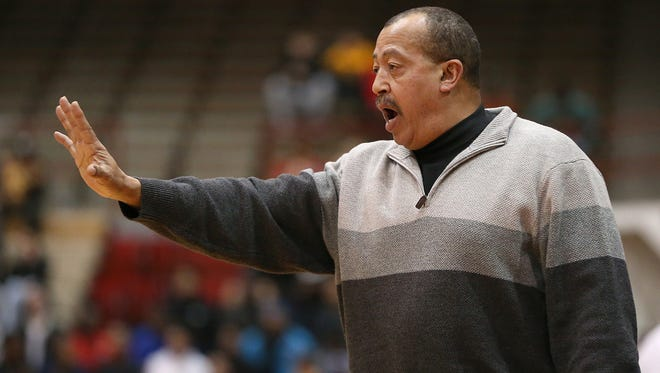North Central Panthers head coach Doug Mitchell signals to players during second half action between Pike and North Central in Marion County boys finals, at Southport High School, Indianapolis, Saturday, Jan. 14, 2017. Pike won, 71-64.