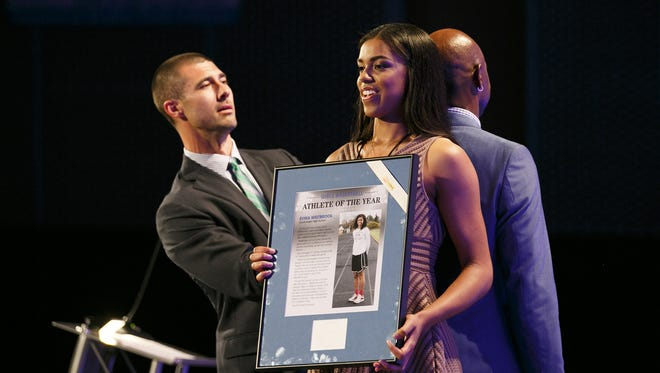 Joey Harrington compares the height of Jerry Rice against South Salem's Evina Westbrook as she is recognized during the Mid-Valley Sports Awards banquet on Tuesday, June 7, 2016, at the Salem Convention Center.