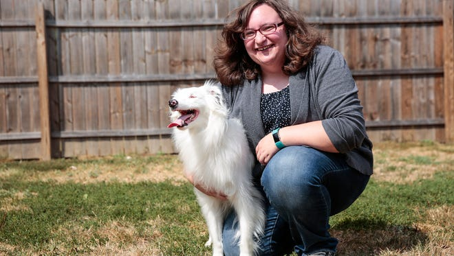 Rose Adler of Ypsilanti Township, poses for photo with her a 2-year-old blind and deaf Australian shepherd Braille, at her home in Ypsilanti Township, Tuesday,  August 15, 2017.