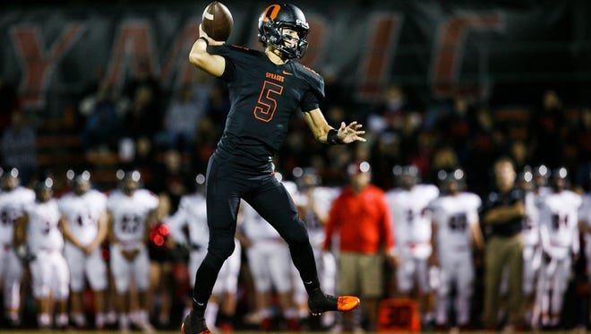Sprague's Spencer Plant (5) throws a pass in a game against McMinnville on Friday, Sept. 22, 2017, at Sprague High School. Sprague won the game 47-7.