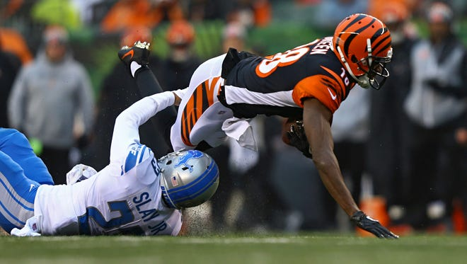 Lions cornerback Darius Slay (23) tackles Bengals wide receiver A.J. Green (18) in the second half of the Lions' 26-17 loss on Sunday, Dec. 24, 2017, in Cincinnati.