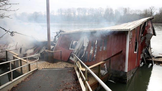 A boathouse burns on the west bank of the Willamette River in Salem on Tuesday, Feb. 20, 2018. The fire was first reported at about 9:30 p.m. Monday and is expected to keep smoking for one or two days.