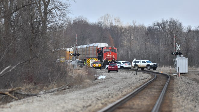 Meridian Township police and fire were at a scene in Haslett Tuesday afternoon where a train was stopped just East of Carlton Street near East Lake Drive. An ambulance was also at the scene.