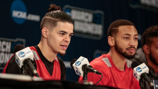 Houston guard Rob Gray, left answers a question during a press conference before second round of the NCAA tournament at INTRUST Bank Arena in Wichita, Kan., Friday, March 16, 2018. Next to him is guard Galen Robinson Jr.