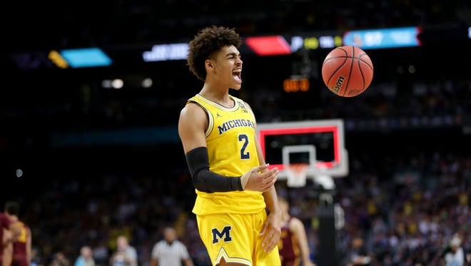 Jordan Poole celebrates Michigan's 69-57 victory over Loyola-Chicago in the national semifinal Saturday at the Alamodome in San Antonio.