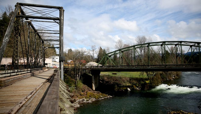 A former railroad bridge, turned pedestrian bridge and the North Santiam River Bridge will be restored thanks to an $8.1 million federal grant. Photographed in Mill City on Friday, April 6, 2018.