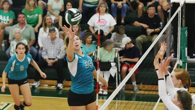 Jensen Beach High School's Madi Bell scores against Fort Myers during the Class 6A volleyball semifinals Saturday at Fort Myers High School.