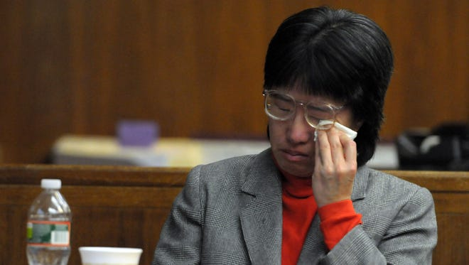 December 19, 2011 --- Jenny Tran wipes away tears while watching a taped interview of her with detectives from the Bergen County Prosecutors Office on the day her husband Minh Trung Tran was killed. Tran is on trial for murdering her ailing husband.