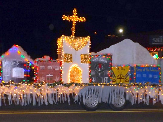 A float recreates a street scene for the Festival of lights Parade.