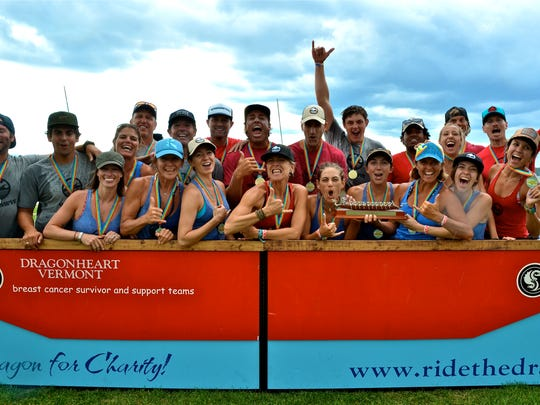 The WND&WVS team celebrates winning the Champ Award at the Dragon Boat Festival on the Burlington Waterfront on Sunday.