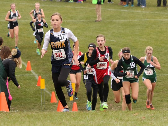 Eden Valley-Watkins/Kimball's Cailyn Kuechle leads a group of runners near the finish of the 5K course during the State class A cross country meet Saturday in Northfield.
