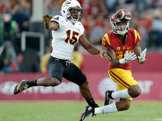 Southern California wide receiver Deontay Burnett (80) catches the ball against Arizona State defensive back Bryson Echols (15) during the first half of an NCAA college football game Saturday, Oct. 1, 2016, in Los Angeles. (AP Photo/Ryan Kang)