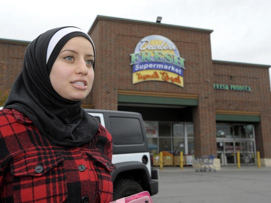 """""""Someone might see me walking around my neighborhood and get scared because I wear a headscarf and think I'm (a terrorist),"""" said Malak Farhat, of Dearborn, who is Muslim. """"But I'm not."""""""